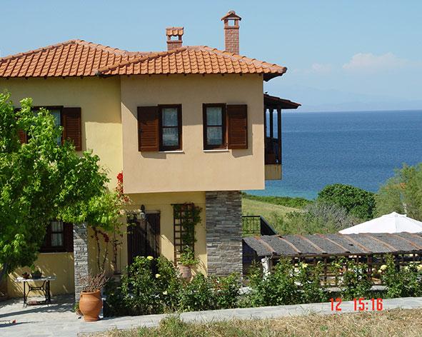 Дома в остров Халкидики с видом на море