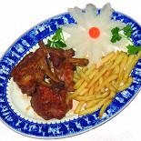 Ресторан Синяя река - фотография 6 - Корейка молодого барашка на углях, 396 руб.  Отборная корейка молодого барашка (н. Зеландия) знаменита своим нежным мясом.