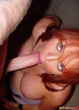Brunette two large dildos