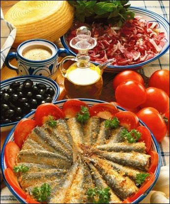 Сардины, запеченные с белым вином и панировочными сухарями